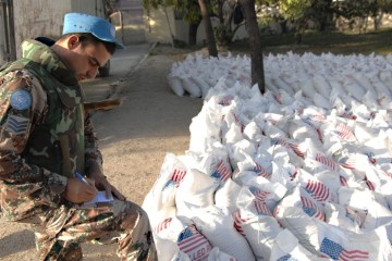 100213-N-5961C-001 PORT-AU-PRINCE, Haiti (Feb. 13, 2010) A Jordan U.N. peacekeeper prepare to distribute 904 bags of rice at an aid distribution point in Port-au-Prince, Haiti. The site was previously administered by the U.S. Army 82nd Airborne Division, but is now being managed by U.N. forces. (U.S. Navy photo by Senior Chief Mass Communication Specialist Spike Call/Released)