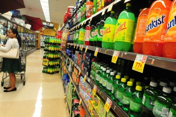 A woman shops for frozen foods on an aisle across from sodas and other sugary drinks for sale at a superrmarket in Monterey Park, California on June 18, 2014, a day after a bill in California that would require soft drinks to have health warning labels failed to clear a key committee. Under the measure, sugary drinks sold in the most populous US state would have had to carry a label with a warning that sugar contributes to obesity, diabetes and tooth decay and the legislation, which would have been the first of its kind in the United States, passed the state Senate in May, but on it failed to win enough votes in the health commission of the California State Assembly on June 17, the Los Angeles Times reported. AFP PHOTO/Frederic J. BROWN        (Photo credit should read FREDERIC J. BROWN/AFP/Getty Images)