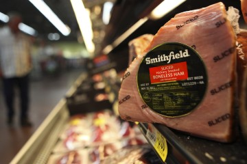 FILE - In this Sept. 6, 2011 file photo, shows a Smithfield ham at a grocery store in Richardson, Texas.  Chinese meat processor Shuanghui International Holdings Ltd. agreed Wednesday, May 29, 2013, to buy Smithfield Foods Inc. for approximately $4.72 billion in a deal that will take the world's biggest pork producer private.  (AP Photo/LM Otero)