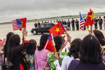 A crowd of roughly 120 people, mostly Vietnamese-Americans waving flags of both countries, and some dressed in traditional Vietnamese attire, attend the arrival of Nguyen Phu Trong, general secretary of Vietnam's Communist Party, at Joint Base Andrews, Md., July 6, 2015. Trong is scheduled to meet with President Obama July 7, which will be the first visit at the White House since the two countries normalized relations about 20 years ago. (U.S. Air Force photo by Senior Master Sgt. Kevin Wallace/RELEASED)